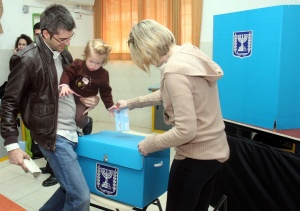 An Israeli family casts her ballot at a polling station